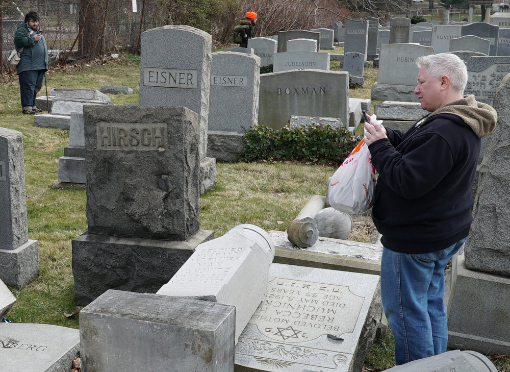 Cemetery visitors documenting the damage with their smartphones. Mount Carmel Cemetery, Philadelphia, PA.