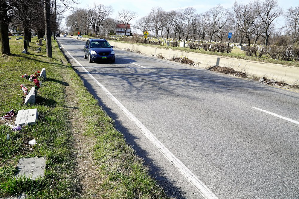 Mount Lawn Cemetery, Sharon Hill, PA: A busy four lane highway cuts through the cemetery. Headstones are just 3 or 4 feet from the highway in some areas. These headstones could easily get damaged if a vehicle veers off the road.