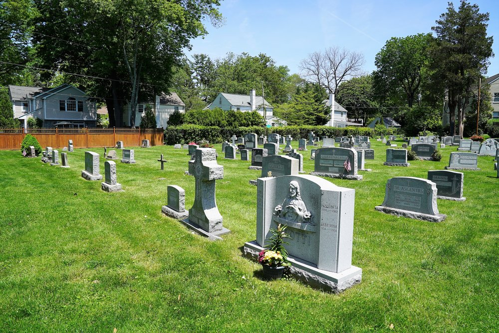 The backyard cemetery at Our Lady Of Assumption Church. Wayne, Pennsylvania.