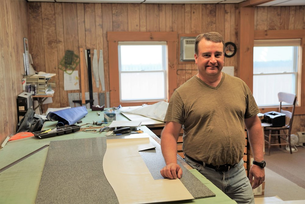 Tim, our draftsman in Vermont. He designs your stone, then makes the stencil which is used in the sandblasting process.