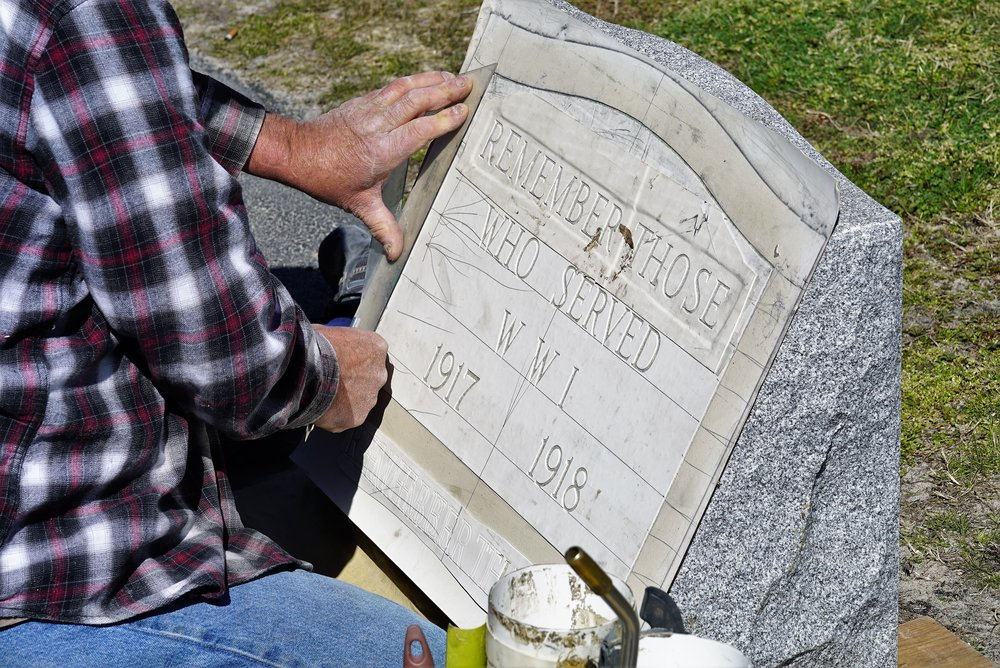 One of our inscription tradesmen, preparing a stencil for the World War 1 monument we made for the town of Brookhaven.