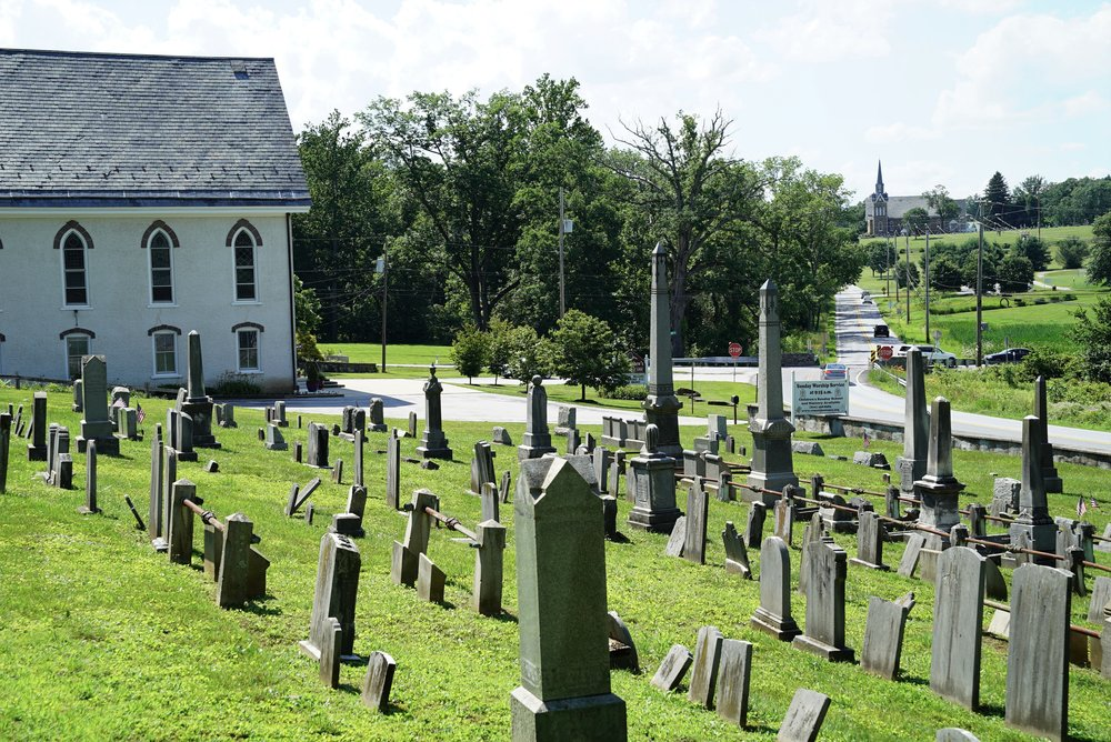 St. Matthew's United Church Of Christ Cemetery. Another church is seen in the distance. Chester Springs, Pennsylvania.