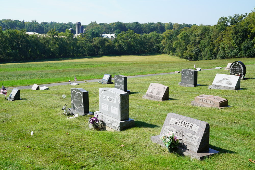 Parkerford Baptist Church Cemetery has a rural setting, with nuclear reactor cooling towers nearby.