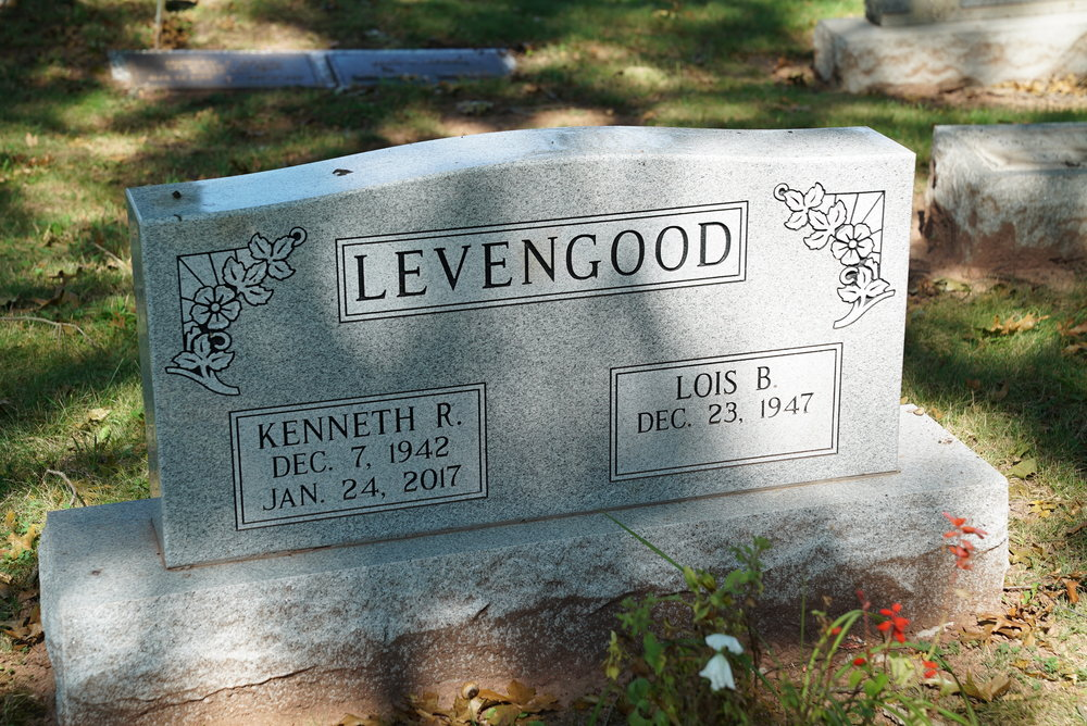 Many cemeteries do not allow lettering and carvings to be painted black, like this stone has.