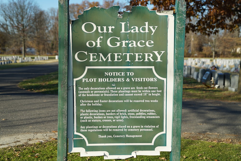 A sign at Our Lady of Grace Cemetery. Middletown Township, Bucks County, Pennsylvania.