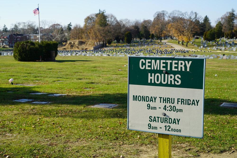 The posted hours. Chelten Hills Cemetery. Philadelphia, Pennsylvania.