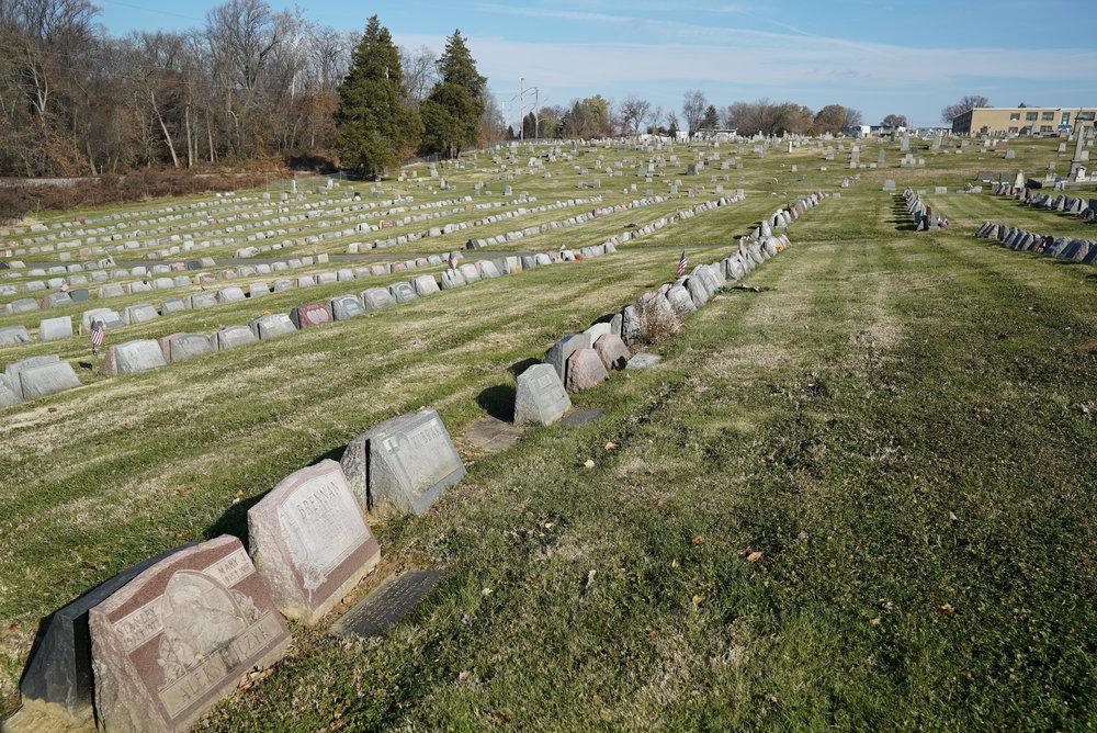 Lots of slant markers at Saint Dominic Roman Catholic Church Cemetery. Philadelphia, Pennsylvania.