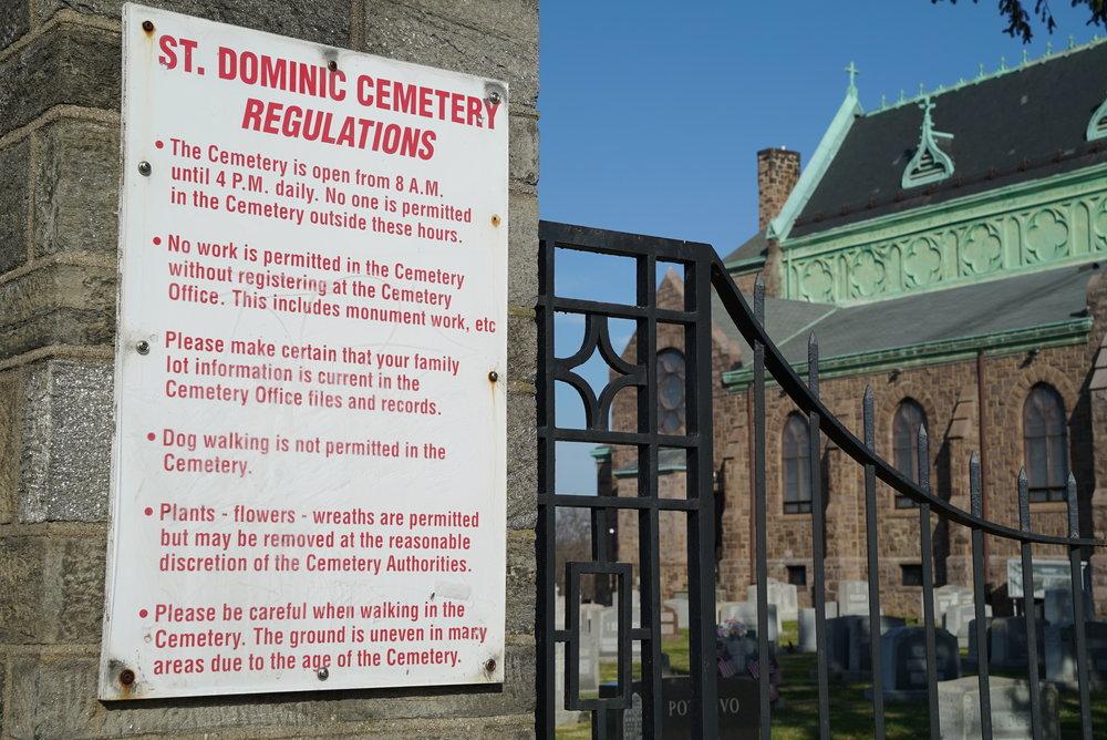 Sign at the entrance to Saint Dominic Roman Catholic Church Cemetery. Philadelphia, Pennsylvania.