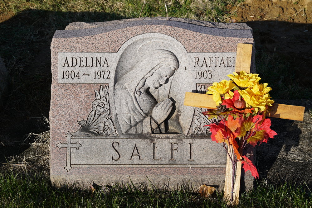 A slant marker with a hand-carved design element (rare). Saint Dominic Roman Catholic Church Cemetery. Philadelphia, Pennsylvania.