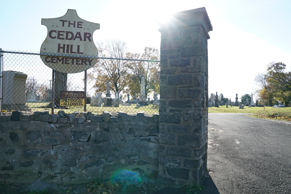 At the main entrance to Cedar Hill Cemetery. Philadelphia, Pennsylvania.