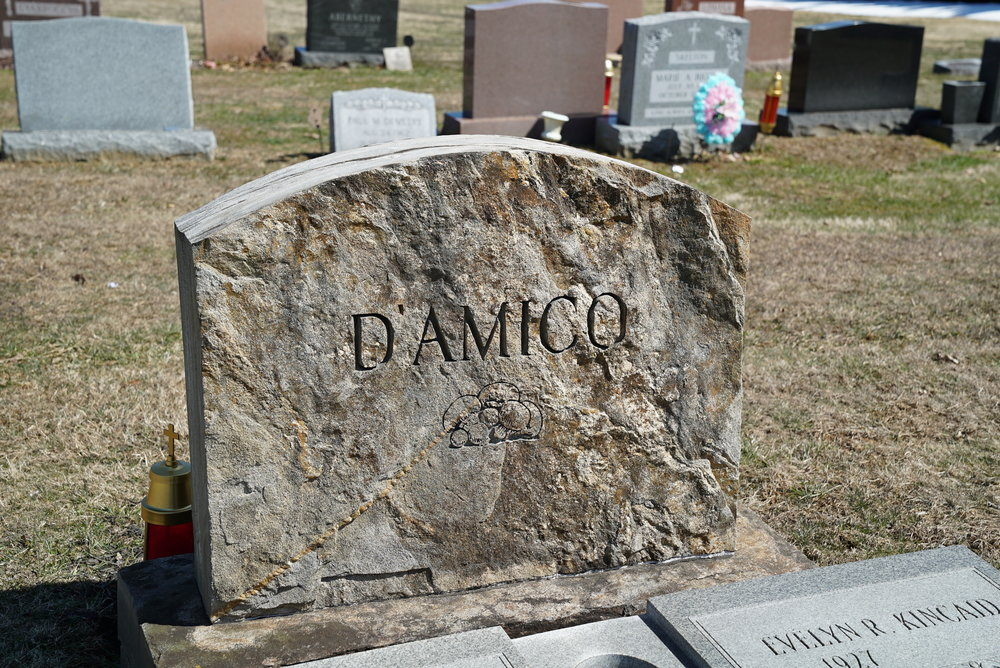 Very unusual tombstone cut from a rock other than granite. St. Patrick's Cemetery. Kennett Square, Pennsylvania.