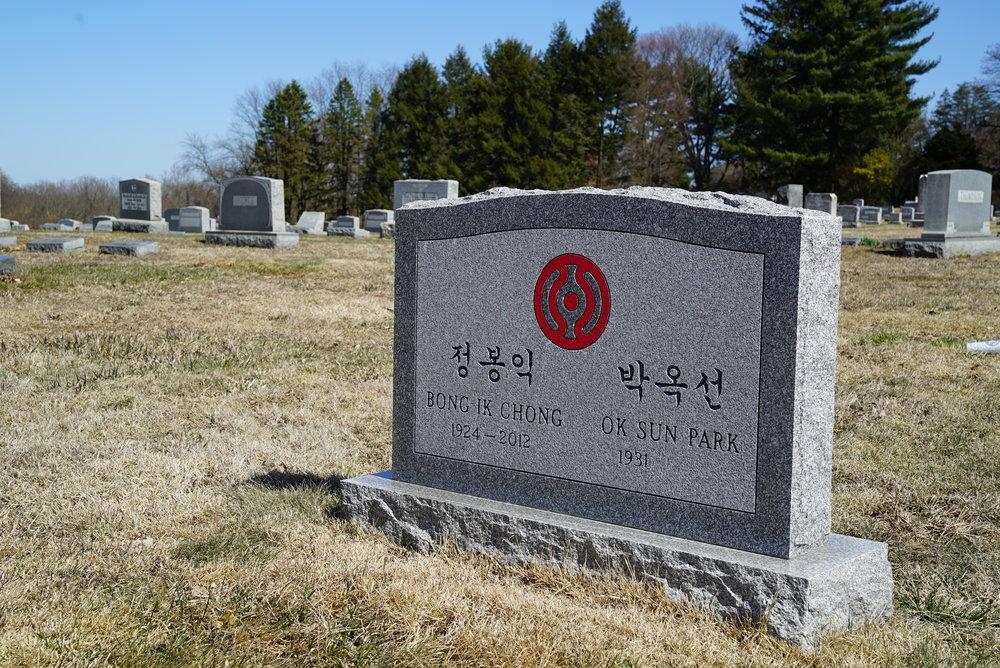 Colored gray tombstone. Unionville Cemetery. Unionville, Pennsylvania.