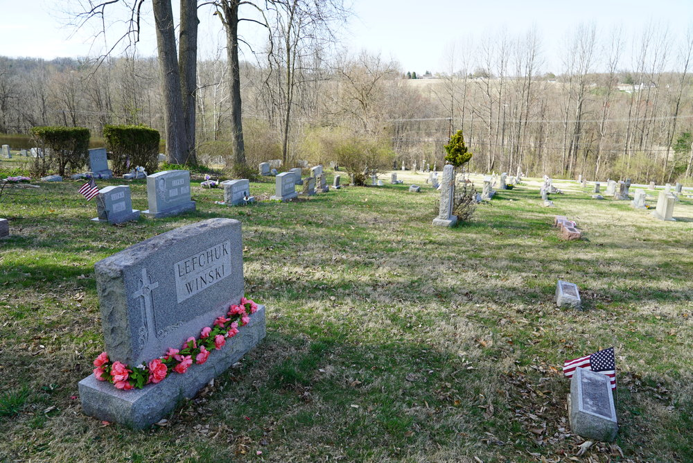 A decorated tombstone at St. Stanislaus Cemetery. Coatesville, Pennsylvania.