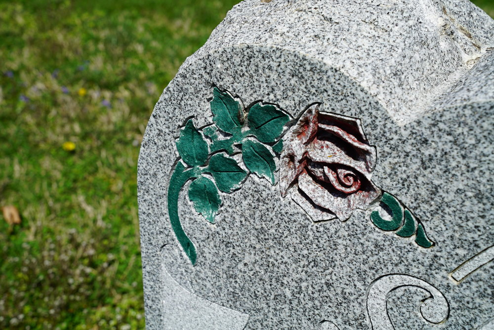 This painted effect on granite shows that paint does not last. It wears off. Pennington Presbyterian Church Cemetery. Atglen, Pennsylvania.