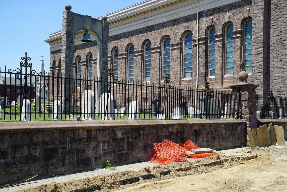 Sidewalk construction at t. Anne's Church Cemetery. Philadelphia, Pennsylvania.