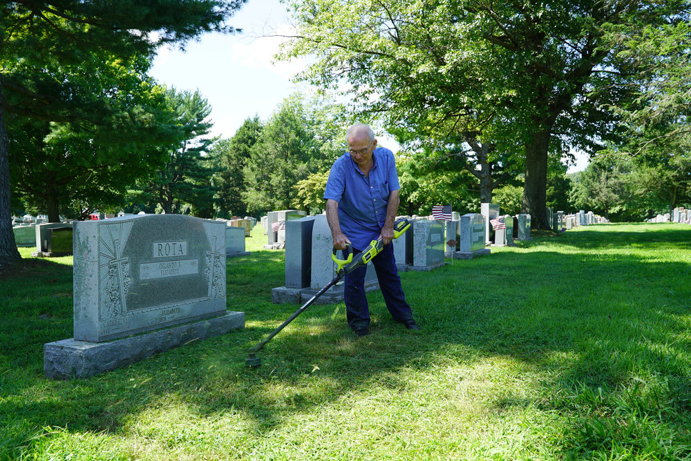 August 23, 2018 at Saints Peter & Paul Cemetery, Springfield, Pennsylvania. Dissatisfied with the recent grounds maintenance standards at the cemetery, Mr. Rota takes matters into his own hands with his electric string trimmer.