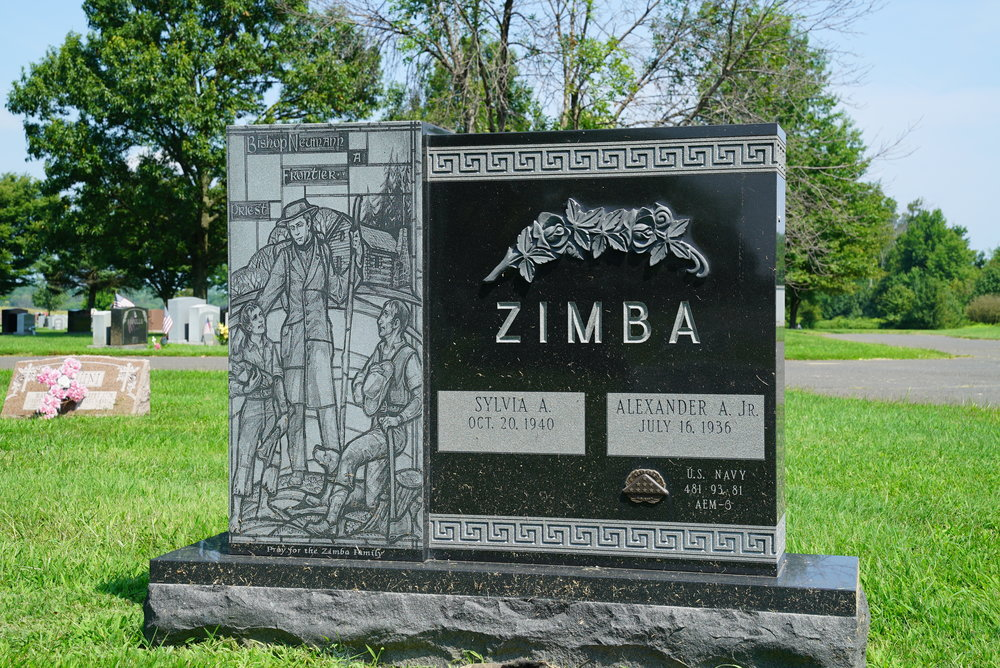 The Zimba stone has a bronze veteran medallion. They are provided free by the Department of Veterans Affairs.