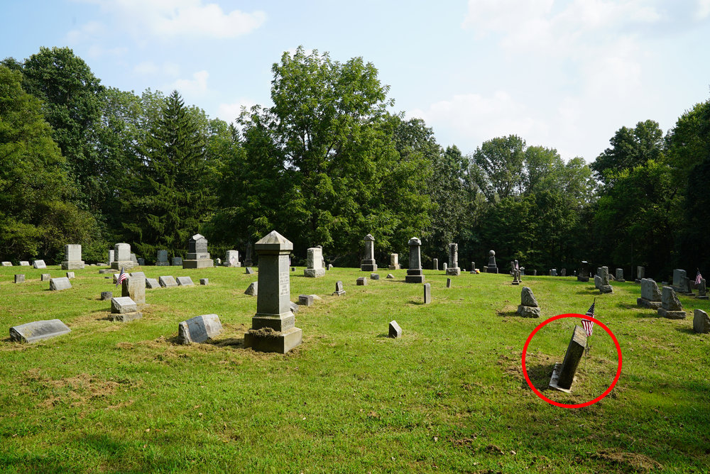 Watch out for leaning headstones like this. They are risky. Stay clear of them. Don't let children get near them.