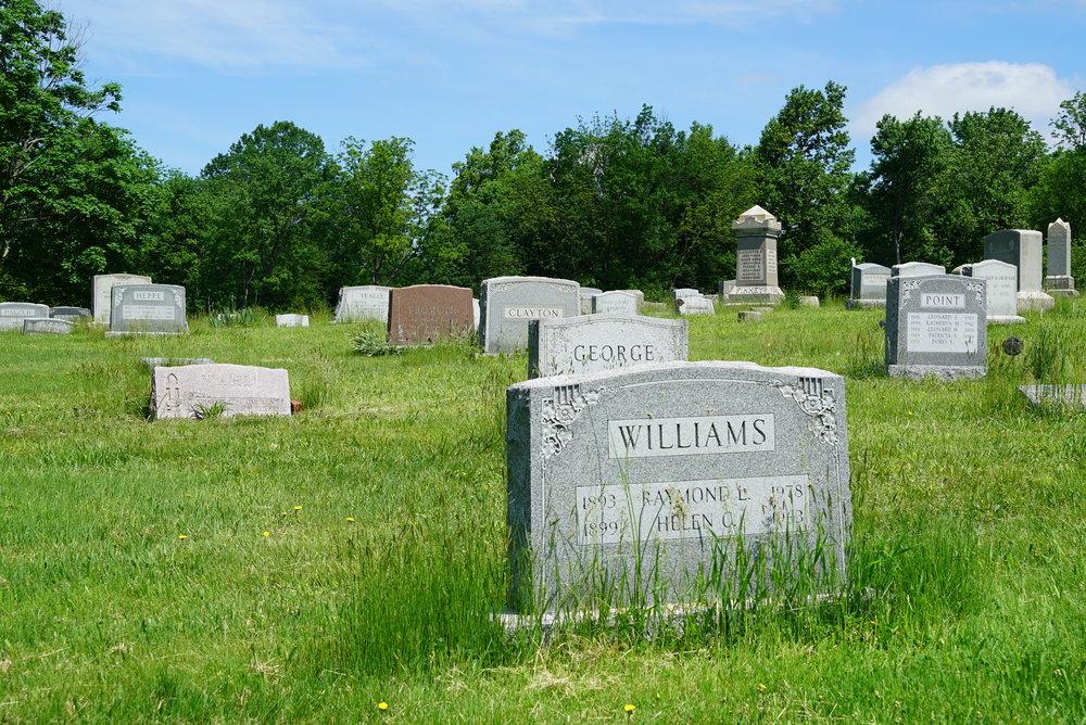 Sloppy cemetery grounds maintenance.