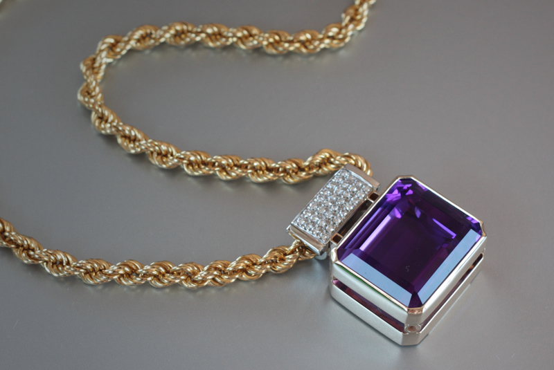 22x18 mm emerald cut amethyst pendant with .5 ct. t.w. of diamonds on an 18k yellow gold chain