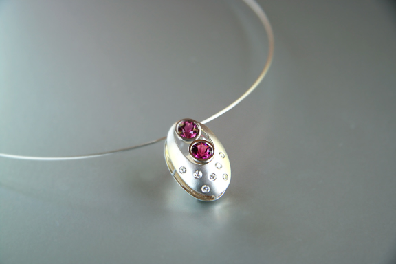 14k white gold domed sandwich pendant with 2 pink tourmaline and burnished diamonds