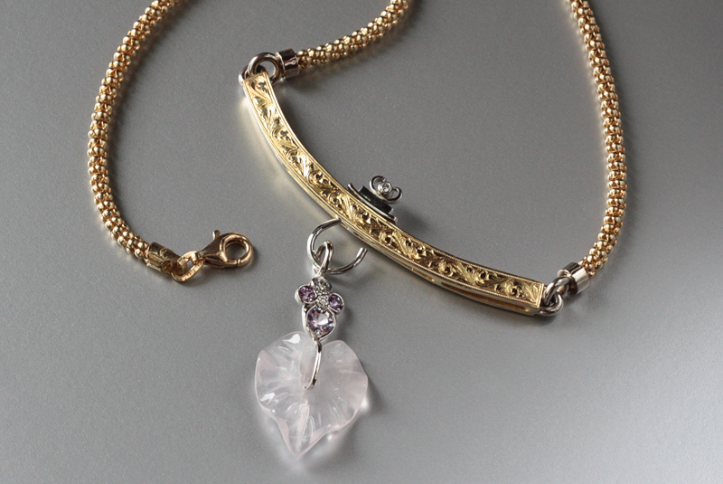 18k handmade, hand-engraved neckpiece with a pink quartz, pink sapphire and diamond dangling charm