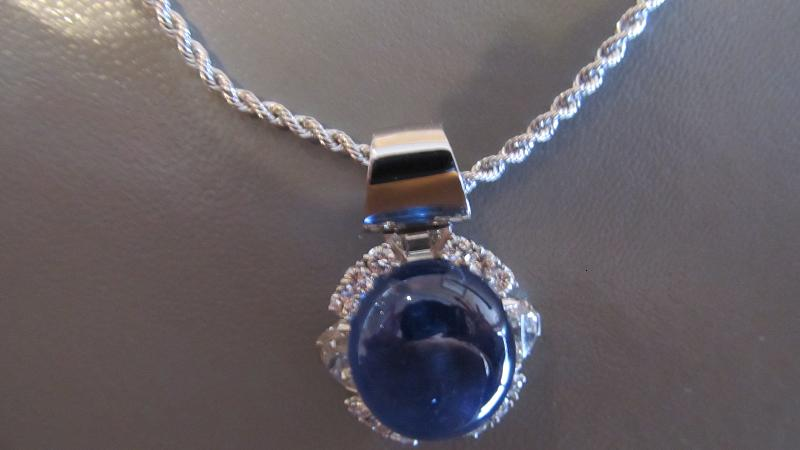 Platinum Gem Star Sapphire pendant with diamonds