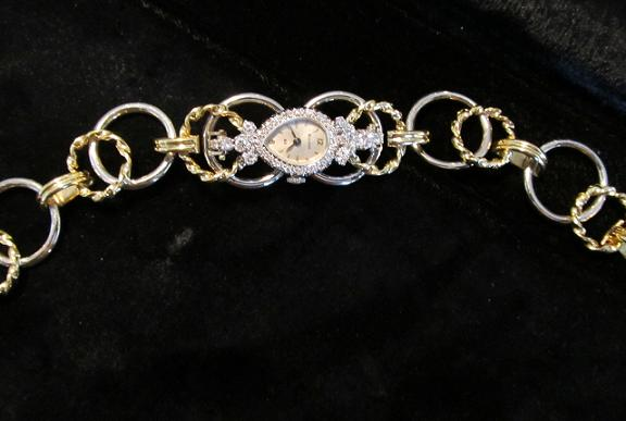 18k yellow gold and white gold hand made bracelet. Restoration of customer's 14k white gold diamond watch.