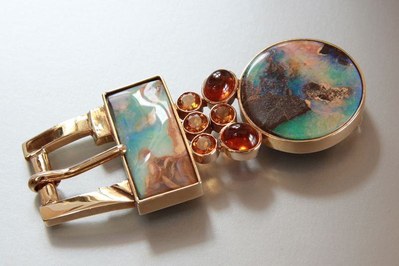 Wind River-  18k yellow gold buckle set with 2 sister pieces of boulder opal, hessonite and topaz