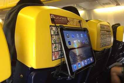 Ipad on Ryanair with TabletHookz.com TabletHookz Tablet Hooks theairhook airhook tablet hook tablet stand Watch ipad on plane Watch movie on plane kids entertainment when travelling seatback