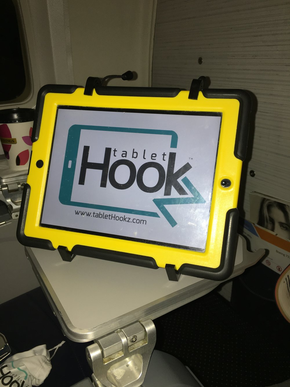 TabletHookz.com TabletHookz Tablet Hooks TabletHookz theairhook airhook tablet hook tablet stand Watch ipad on plane Watch movie on plane kids entertainment when travelling seatback entertainment