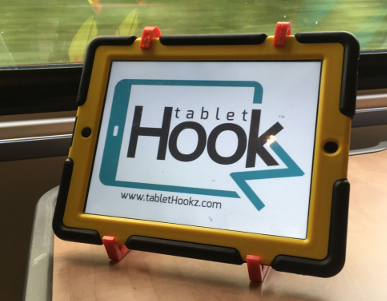 Tablet Hooks holding an ipad on the train, TabletHooks have suction feet it prevents the device from siding around. TabletHookz.com Watch ipad on plane Watch movie kids  travelling