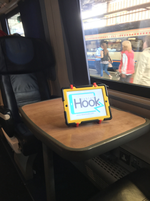 TabletHookz holding an ipad on the train, TabletHooks have suction feet it prevents the device from siding around. TabletHookz.com Watch ipad on plane Watch movie kids  travelling