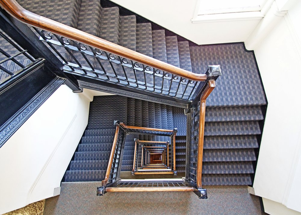 caxton building staircase looking down
