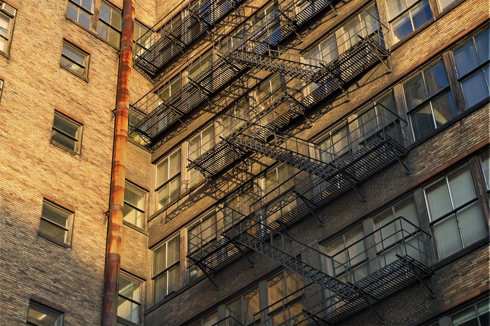caxton building fire escape at sunset