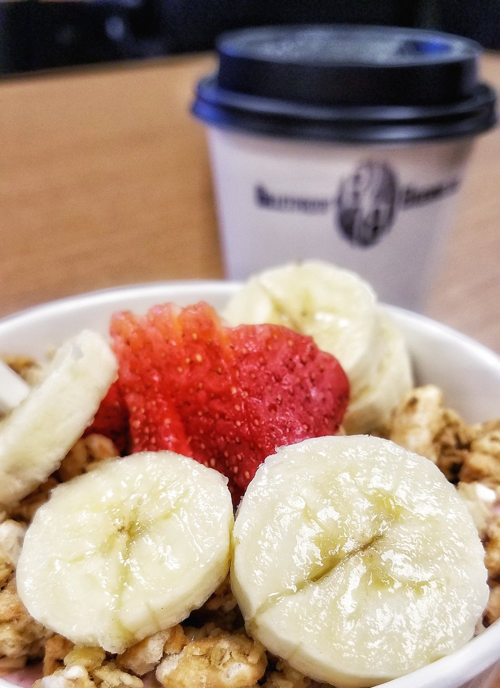 Strawberry bannana bowl with hemp granola, and coffee! Photo by London Howell-Farley