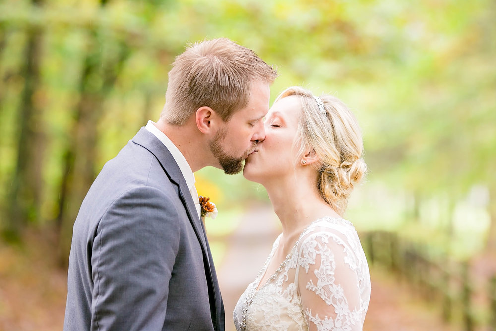 Bride and groom kiss, fall wedding