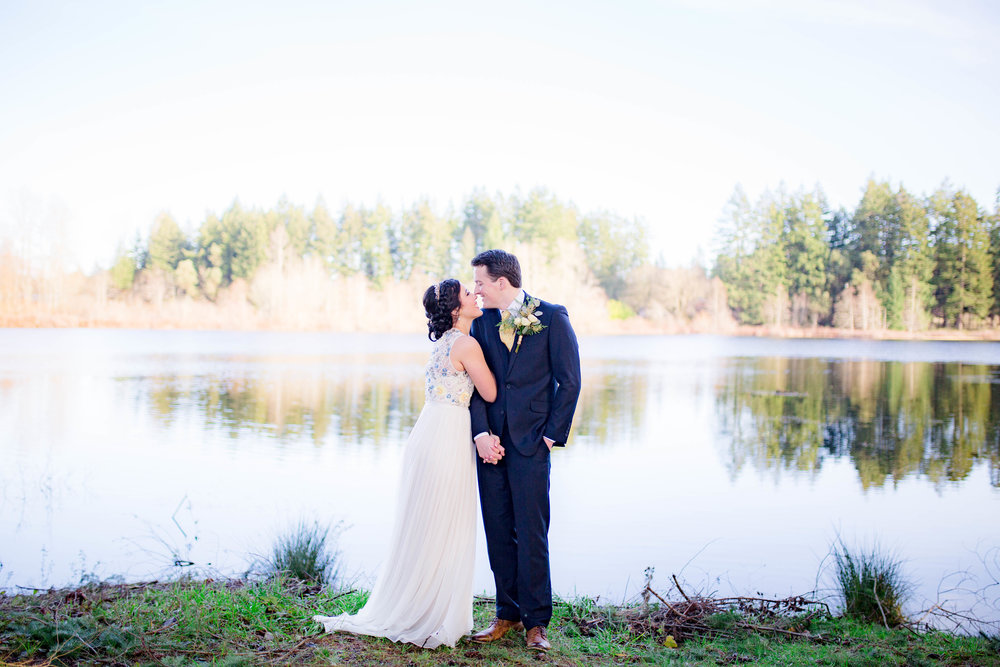 Bride and groom lakeside first look