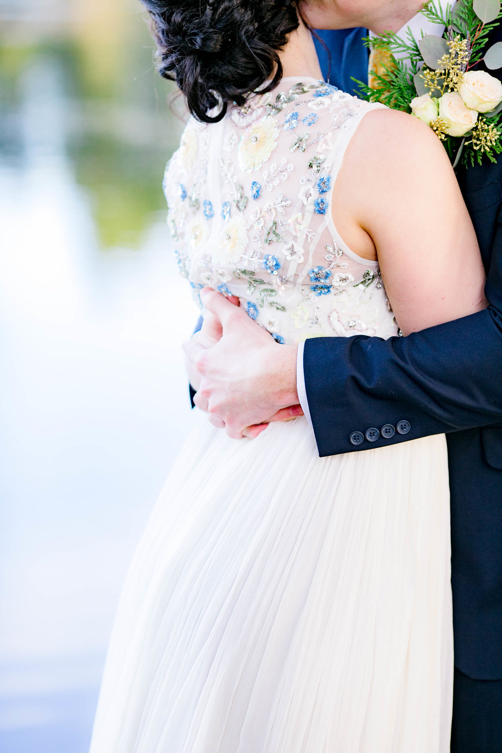 Bride and groom embrace