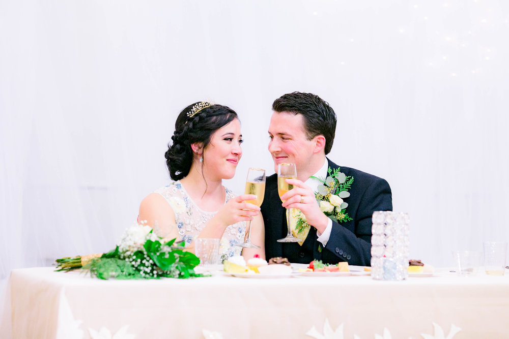 Reception bride and groom head table, sweetheart table