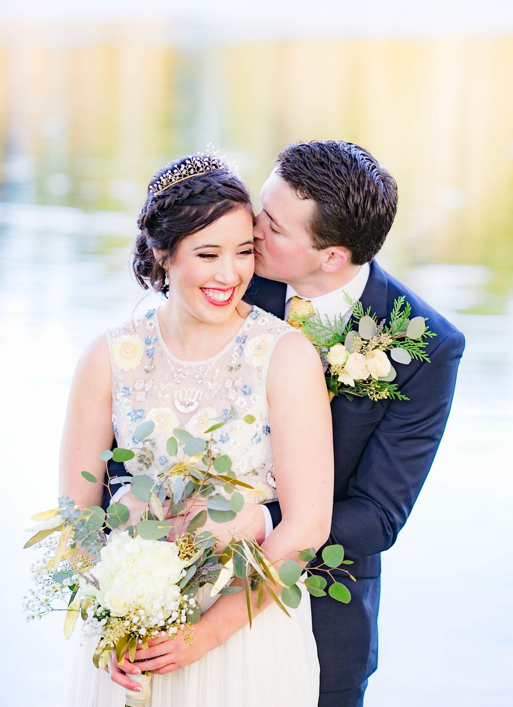 Bride and groom cheek kiss