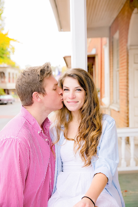 Downtown Jonesborough, TN sunrise engagement session cheek kiss