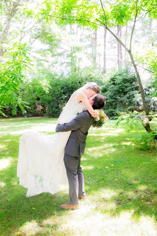 Hot Springs, NC wedding, East Tennessee Wedding photography, groom lifting bride