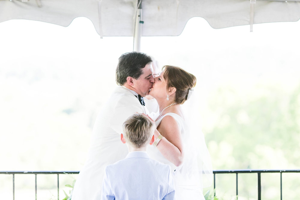 Johnson City Country Club wedding, East Tennessee wedding venue, Tri Cities TN wedding photographer, wedding ceremony, balcony wedding, first kiss