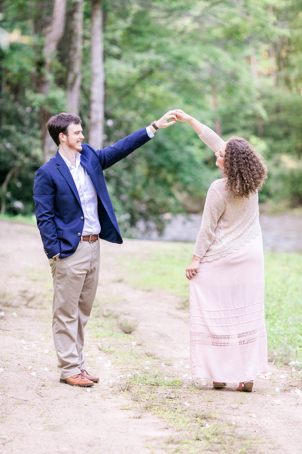 East Tennessee engagement session, wedding photographer, portrait photography, bride and groom, Doe River Gorge, wedding venue, Tri Cities wedding photographer, Johnson City, twirling couple