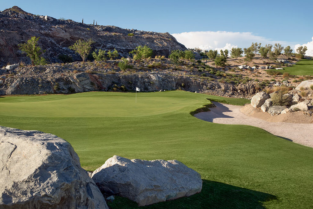 - We were able to bring in very large boulders that helped define the green complex and give a natural appearance and great back edge to the bunker right of the green. It was very important to us that this hole, which starts with a view of everything, ended up with a very secluded, intimate and rocky setting.  We very much enjoyed the contrast between the two elements and are hopeful that everyone else appreciates it as well.The greens construction was a tremendous experience for us.  Again, without the d9's, what we ended up with would have been difficult.  The material that the green subgrade was built on could only be moved with a large dozer and just barely at that.  We had to rip a few inches of material at a time and shove that material towards the tee. If you're on site a lot you have a chance to be there when opportunities arise.  We were on site a lot.  After pushing material and getting shapes that were manageable, a low developed on the front right that was there due to pushing material to the left.  It was the first solid idea for finishing the green.  We had a large rock outcropping that we hit on the front left, we kept it large like it was.  We had a large roll off to the left that we loved and after some time we finally had a green that was pinnable and interesting. It took a lot of effort by many but the 18th green is something we are very proud of and something we thoroughly enjoyed creating.  A big thanks to DMB for allowing us the opportunity.
