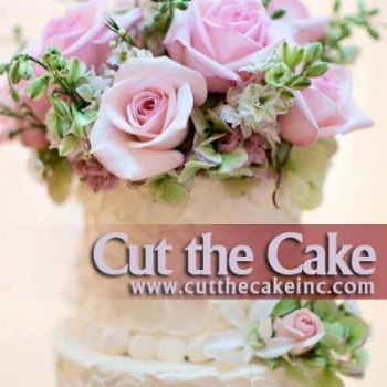 cut the cake inc logo wedding cake with flowers pink roses