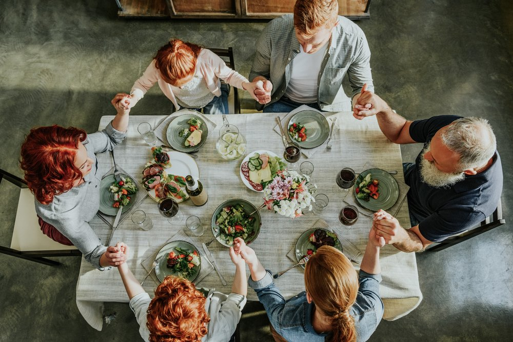 bigstock-Family-Praying-During-Dinner-206028484.jpg