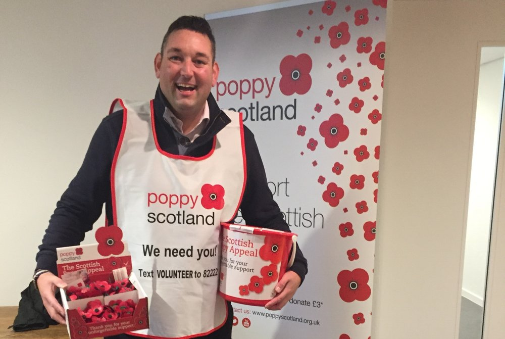 Miles collecting money for Poppy Scotland