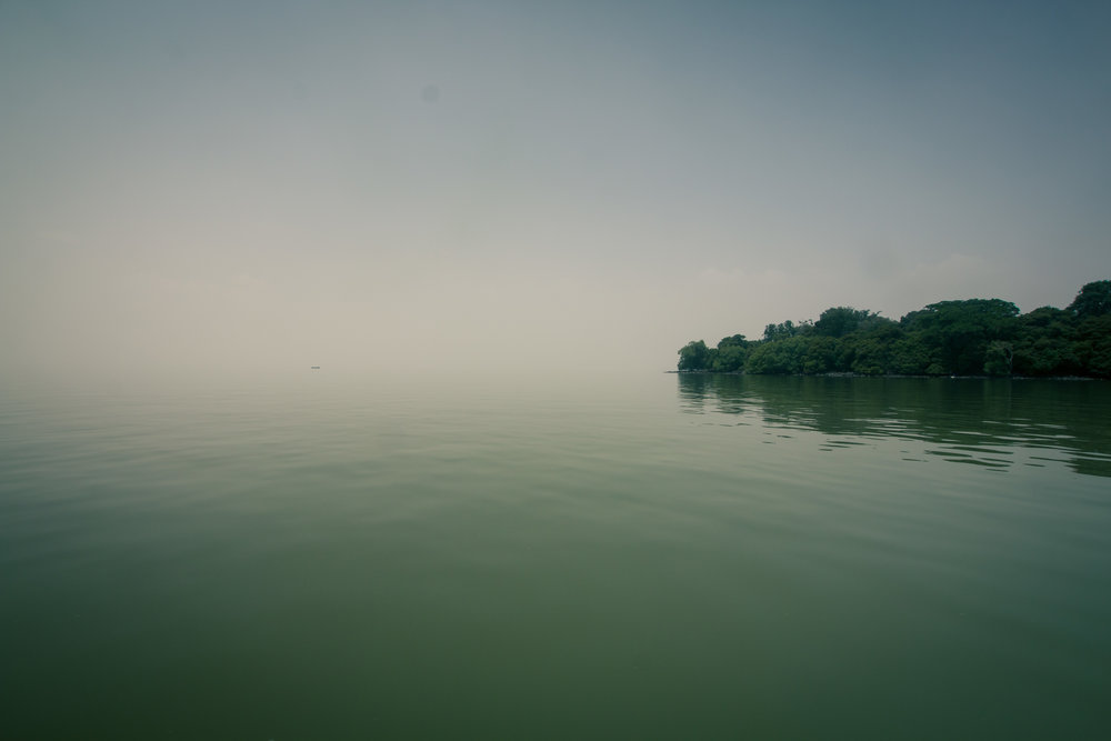 Where foggy skies meet water in the early morning of Lake Tana.